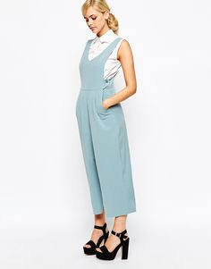The cinched waist adds the appearance of longer legs and therefore creates the 3:5 ratio.