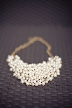 all-things-bright-and-beyootiful; pearlsandpoltics:  Great pearl necklace. Love the random placement of rhinestones.