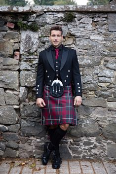 The Hunting MacGregor Tartan is a favourite for winter weddings due to it's festive tones. Combined with a traditional Prince Charlie and black accessories makes for a perfect groom's outfit.