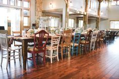 Farm tables with mixed matched Chairs make for a great focus piece in the room when you are going for a vintage vibe!  :)
