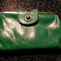 GENTLEY LOVED HOBO INTERNATIONAL WALLET ! 25.00 GENTLEY LOVED HOBO INTERNATIONAL WALLET EMERALD GREEN SOME SCRUFFING ON THE EDGES ALL STITCHING INTACT  NO STAINS I already lowered this wallet from $35.00 to $25.00 this is as low as I can go. Sorry HOBO Bags Wallets