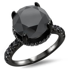<li>Black diamond engagement ring</li> <li>18k black rhodium-plated gold jewelry</li> <li><a href='http://www.overstock.com/downloads/pdf/2010_RingSizing.pdf'><span class='links'>Click here for ring sizing guide</span></a></li>