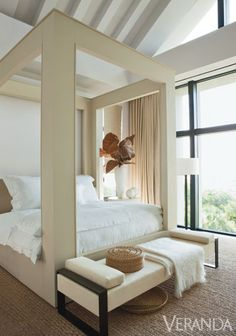 Natural textures keep clean lines from feeling cold. Custom bed. Linens, Anichini and Matouk. Curtains and Holly Hunt daybed in de Le Cuona fabric. Throw, Matouk. Vase and spheres, Robert Kuo. Lamp, Holly Hunt. Rug, Stark.    - Veranda.com