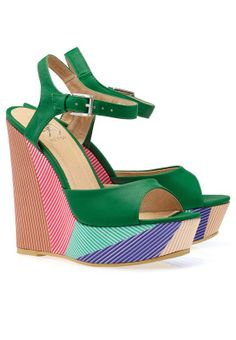 Elegant yet strikingly fashionable! These trendy wedge heels add an instant splash of color to your outfit. #namshi  #wedge #heels #fashion
