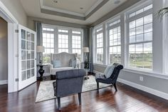 Love the tray ceiling and the big windows in our sitting room at Colvard Choice