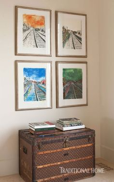 A series of framed pieces by Bob Dylan welcome above a vintage trunk in this home's foyer. - Photo: Michael Garland / Design: Kazuko Hoshino