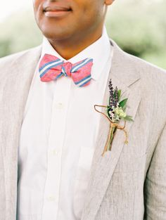 Bright, preppy bowtie and a rustic boutonniere: http://www.stylemepretty.com/2014/12/16/romantic-southern-cottage-wedding/ | Photography: Katie Stoops - http://katiestoops.com/
