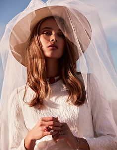 Rozanne Verduin models Maria Barragan dress and Mimoki hat covered with veil. Photo: Tomás de la Fuente