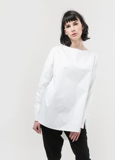 Paper white poplin oversized boatneck shirt blouse with wide cuffs. Features asymmetric hems. Relaxed and cropped fit. Mindfully hand made in Vancouver, Canada, in collaboration with local small-businesses. Fabrics all sourced from the west coast of North America. Worn with the Priory Cheon pants and Mari Giudicelli leblon mules. CARE Hand wash cold (lay flat to dry). MATERIAL 100% Japanese cotton. FIT Julia is 5'9, waist 34, hips 31.5, dress size 4US, shoes 8.5US and wears the size small...