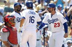 Los Angeles Dodgers' Andre Ethier (16) with St. Louis Cardinals catcher Yadier Molina, left, looking away, gets congratulations from Matt Kemp, second from left, and Adrian Gonzalez (23) after hitting a three-run home run in the fifth inning of a baseball game on Sunday, June 29, 2014, in Los Angeles. (AP Photo/Alex Gallardo)