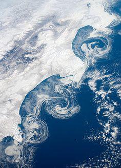 Satellite Eye on Earth: Ice Floes Along the Kamchatka Coastline