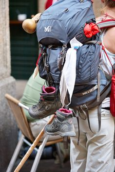 Pilgrims on the Camino de Santiago Tie things to the outside of your back pack for easy drying.