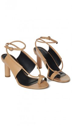 A simple statement shoe with a wood grain enamel heel, this sandal features a toe ring and strappy details making it a perfect option for a night out.  Seta Calf LeatherMade in Italy Style Number: SS117AUB5170Available in: Navy, Ivory, Tea Rose