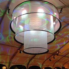 Gigantic white LED lanterns project multicolored spirals from the tent ceilings at The Q. #sobewff