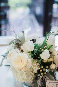 Table Arrangement. White hydrangeas, garden roses, tulips, berries, dusty miller, anemones. Photo Courtesy of Lauren Rathbun Photography.