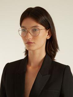d06b369e32adb2 Click here to buy Prada Eyewear Round-frame metal glasses at  MATCHESFASHION.COM Round