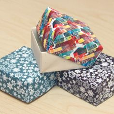 How to make folded paper gift boxes using colorful scrapbook paper.