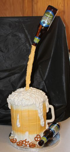 Floating beer glass pouring into a beer mug cake.