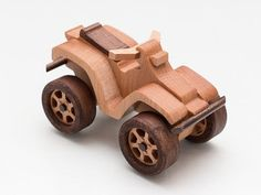 I made this Quadrocycle wooden toy off-road vehicle from beech, maple and oak. Vehicle with rotating wheels. No nails or screws, just glue, natural linseed oil. All very child-safe. Dimension: Length: 5.25 inches (13.3 cm) Width: 3.0 inches (7.5 cm) Height: 3.26 inches (8.3 cm) Weight: