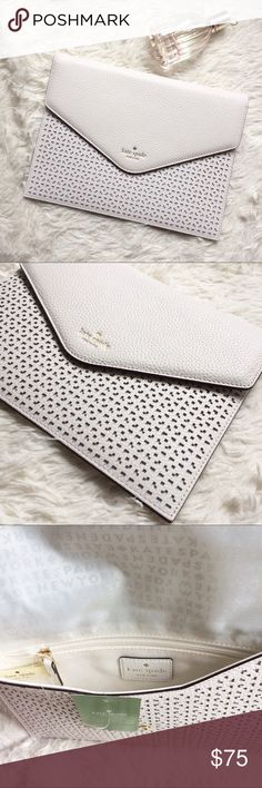 kate spade Envelop Clutch Beautiful laser cut design! The white hue is great with pairing with any summer outfit. kate spade Bags Clutches & Wristlets
