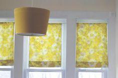 3 vintage pillowcases + tension rods = very sweet window coverings