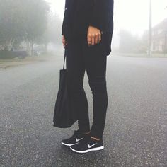 all the fashion chicks have been wearing these exact black trainers: The Nike Free.