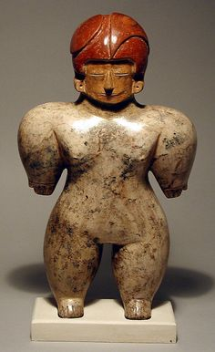 Standing Figure,Chorrera culture,Ecuador 10th-2nd BCE--looks like a football player in full pads and helmit--or maybe modern footballers are imitating this splendid fellow