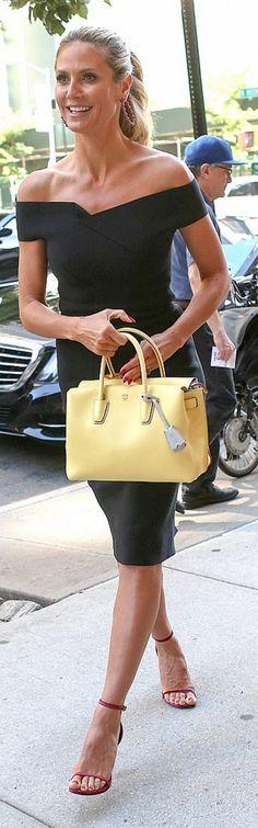 Who made Heidi Klum's yellow tote handbag, black off the shoulder dress, and red velvet sandals?