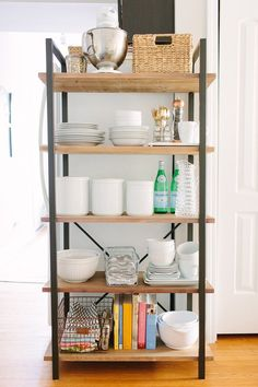 Love the idea of having dishes on an open shelf instead of in a cabinet. Danielle's Charming, Classic Chicago Walk-Up