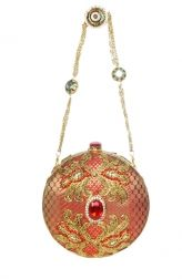 This feminine clutch designed by Meera Mahadevia features elaborate embellishments such as a red semi-precious stone as the central feature and small studied stones surrounding it. The clutch is definitely a work of art, down to the sling, which features sparkly accents. This glamorous clutch deserves to be styled with an equally exquisite outfit.
