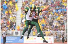 Edmonton Eskimos' Fred Stamps, left, celebrates a his touchdown with teammate Cary Koch during first half CFL action against the Hamilton Tiger-Cats in Guelph, Ont., Sunday, July 7, 2013. Photograph by: Aaron Lynett , THE CANADIAN PRESS