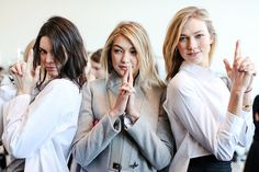 Kendall Jenner, Gigi Hadid, and Karlie Kloss struck a classic Charlie's Angels pose at the Michael Kors Fall 2015 Fashion Show in New York City on Feb. 18.