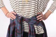 It seems like everyone is tying a shirt around their waist lately. Carly does a good job of mixing patterns in this look. The striped sweater is from Urban Outfitters ($54) and the flannel is from a thrift store ($3). (Allison Carey/The Plain Dealer)