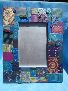 Polymer Clay Mosaic Frame (Blue). $29.99, via Etsy. I would trim the edges evenly and finish it more.