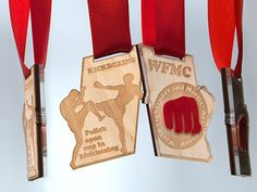 Medals, sport kickboxing plywood , plexiglass colorless . Inset with red plexiglass . Double-sided engraving