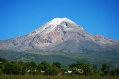 Climate/ Geography: This is a picture of the biggest mountain in Mexico. Pico de Orizaba is the tallest mountain in Mexico. Its 18490 inches tall. This mountain started off to be a volcano but then in the winter it's a mountain.  Scientist have tried to figure out the exact height which is 18490.5 inches. The Northern Mexico is bordered by the United States and Southeast is bordered by Brazil and Guatemala. Mexico is 1/5 of the United States. Overall this is the highest mountain in Mexico.