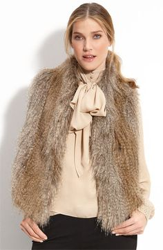 I think I want to have some fox fur pieces that I have made into this vest, gorgeous!