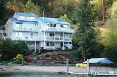 IMPECCABLY REMODELED LAKE COEUR D'ALENE WATERFRONT RETREAT. Enjoy captivating views from every room in the house. Spacious, multi-level decks allow ample opportunities for outdoor entertaining or relaxing and enjoying the gentle breeze off the lake. With 100' of flat sandy beach frontage and the large covered boat dock, this is an ideal location for all your favorite waterfront activities.