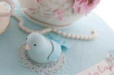 Blue birds & Pearls. Mother's Day high tea teapot & teacup cake, delicately decorated in pink & blue with gold accents. The teapot is filled with yummy citrus white mud layered with matching white ganache. Every single detail is edible.