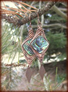 """Herringbone Woven Copper and Paua Abalone Earrings  These babies will take you directly to the tropics! Well, not really, but...  Hand woven copper surrounds blue green paua shell. A copper diamond shape dangles below. Hand created copper french hook ear wires. These are very versatile and easy to wear. Shell patterns will vary.  Approximately 2.75"""" x .75"""", .15 oz each"""