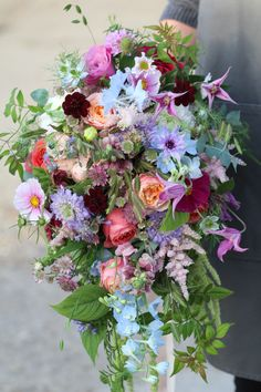 Purple Wedding Flowers Natural and wild hand tied shower bouquet created from a selection of bright and British grown flowers and foliage. Pinks, Purples, Blues, Peach, Dark Reds and Greens Bright Wedding Flowers, Cheap Wedding Flowers, Bridal Flowers, Flower Bouquet Wedding, Bridal Bouquets, Wedding Ideas, Blue Bouquet, Bridesmaid Flowers, Orange Fruit