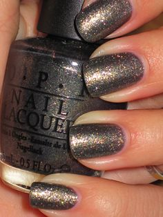 Silver gray with hints of orange specks - Awesome fall color - O.P.I.- Number One Nemesis