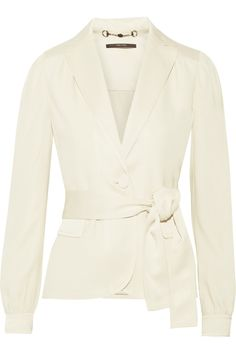 Gucci's satin-trimmed crepe blazer has a cool, retro feel. The pleated shoulders and single button fastening create a flattering, feminine silhouette - enhance the effect with the detachable waist belt. Team yours with the coordinating flared pants. Get the look at NET-A-PORTER