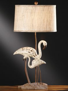 Lovely distressed white and gray finished ocean egrets resin lamp with  Oval Hardback Woven Linen Shade.