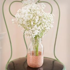To make any old mason jar sparkle, fill it with glitter and flowers! Then get 7 more ideas for DIY wedding decorations: http://www.womenshealthmag.com/life/wedding-decorations?cm_mmc=Pinterest-_-WomensHealth-_-content-life-_-diyweddingdecor