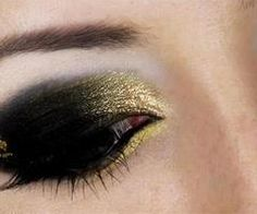 Black and gold eye shadow ...would like this with more blending toward top of lid