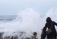 This was spooky, when a huge wave crashed over the old sea wall. The mum frantically grabbed one of the youngsters by the scruff of the neck and they all reached safety, thankfully!