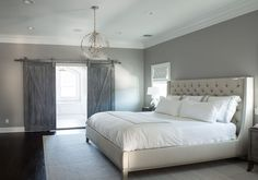 What's not to love? From the paint color, gorgeous bed and linens, barn doors to unexpected light fixture- love 'em all!