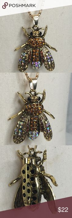 "Bee Necklace/Brooch This piece is amazing! Sparkly Bee on a gold toned mixed alloy 29"" chain. Can be worn as a necklace or simply remove it from a chain and pin it to your favorite sweater, scarf etc and wear it as a brooch. Bee pendant is 2"". New in package. Jewelry Necklaces"
