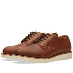 Originally designed to meet the needs of US Postal Service workers, the Red Wing 101 is a sturdy dress oxford, which sits on an extremely comfortable cushion crepe wedge sole. This iteration is expertly crafted in the USA using the finest amber harness leather, the Postman Oxford offers exceptional durability and comfort, with classic styling. Premium Amber Harness Leather Uppers Leather 3/4 Lining with a Thick Leather Insole Atlas Tred Sole Goodyear Welt Made in the USA Style Code: 3101